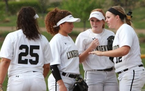 Lindenwood softball players from left to right: Hannah Johnson, Austin Pauley, Morgan Brown and  Lexi Theis speak during a game last year at the Lou Brock Sports Complex. The Lions kick off their season on Feb. 14 against Quincy University. Photo by Don Adams Jr.