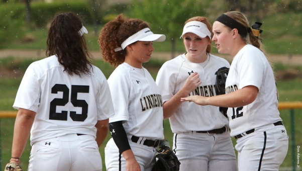Lindenwood+softball+players+from+left+to+right%3A+Hannah+Johnson%2C+Austin+Pauley%2C+Morgan+Brown+and++Lexi+Theis+speak+during+a+game+last+year+at+the+Lou+Brock+Sports+Complex.+The+Lions+kick+off+their+season+on+Feb.+14+against+Quincy+University.+Photo+by+Don+Adams+Jr.