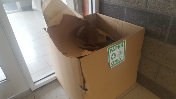 A cardboard box used to collect paper recycling in Guffey Hall Photo by Matt Hampton