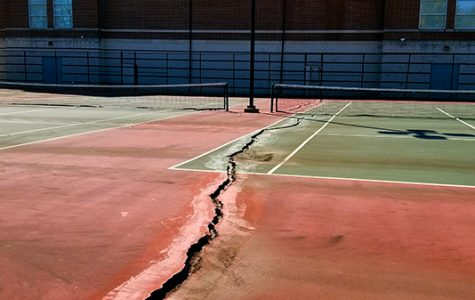 The tennis court directly next to the Hyland Arena has seen better days. Instead of leaving the eyesore as is, the space should be renovated as an outdoor basketball court.  <br>Photo by Michelle Sproat. </br>