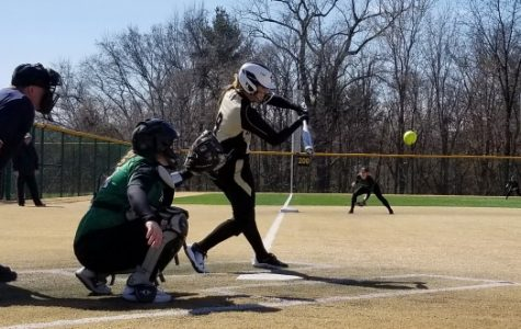 Lindenwood's Megan Clark attempts to make contact at bat while Wisconsin-Parkside's catcher, Megan Aliverti, waits behind the plate.  Lindenwood defeated Wisconsin-Parkside 9-4.  <br> Photo by Michelle Sproat </br>