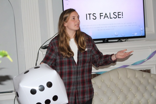 Katherine Yeomans, a freshman in Irwin Hall, answers trivia questions during a life-sized version of Sorry! for Irwin Hall's physical program Wednesday, March 21.  Photo by Abby Stone.