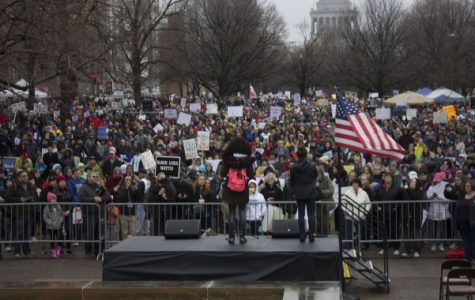 Morgan Lowe, an organizer for the St. Louis March for Our Lives, speaks to the gathered crowd at the kickoff of the event. There were an estimated 10,000 to 15,000 people participating, according to an announcement. <br> Photo by Mitchell Kraus