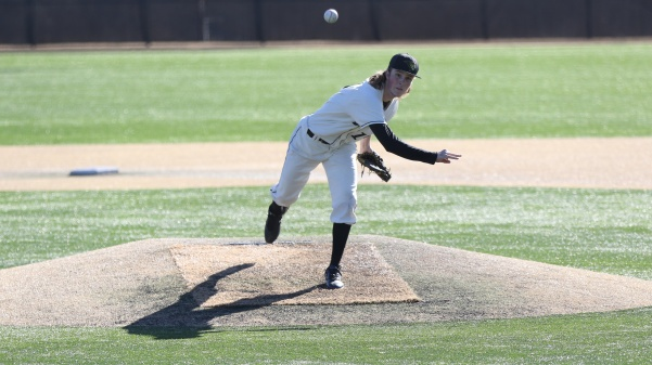 Pitcher+Tyler+Cassmeyer+delivers+a+pitch+in+the+Lions%27+5-2+loss+against+Northeastern+State+on+Feb.+25.+%0A%0APhoto+by+Kyle+Rhine