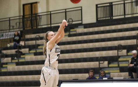 Guard Lindsay Medlen, No. 30, drains a three in Lions' 83-73 win over Lincoln on Feb. 10 at Hyland Arena. <br> Photo by Kyle Rhine