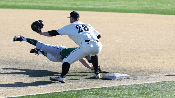 First baseman Neil Fischer, No. 23, attempts to tag out a Northeastern baserunner on a pickoff move from pitcher Tyler Cassmeyer in the Lions' 5-2 loss against Northeastern University Feb 25. at Lou Brock Stadium. <br> Photo by Kyle Rhine