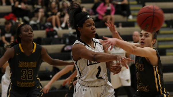Guard Charisse Williams, No.2,  attempts to make a pass to a teammate in Lions' 61-50 win over Missouri Western on Feb. 24.   Photo by Kyle Rhine