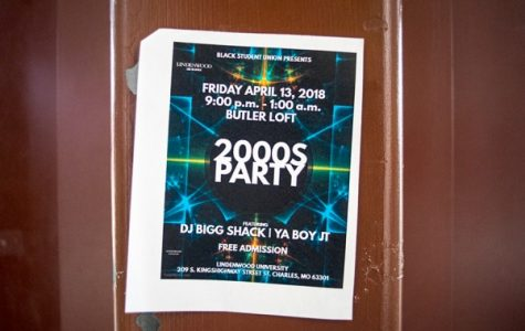 A flyer advertising the 2000s party on a door frame inside Spellmann <br> Photo by Mitchell Kraus