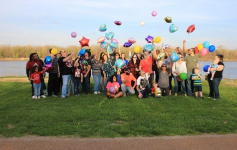 Friends and family gather in Frontier Park Thursday night to release balloons in memory of Tiffany Sabourin. <br> Photo by Lindsey Fiala