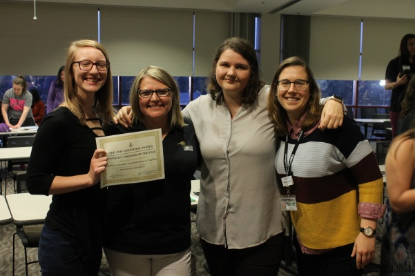 Members of the Gender Sexualities Alliance pose with Angie Royal (second from left) after receiving a diversity award for this semester's drag show, which had a theme of social activism.