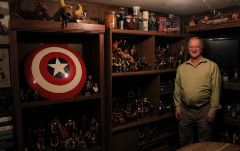 "Quiggins transformed the basement of his house into his own ""mancave."" It is full of artwork, superhero and comic figurines, as well as an entire room that houses his comic book collection of approximately 50,000 comic books. <br> Photo by Lindsey Fiala"