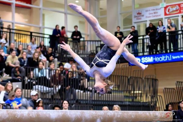 Andavea Alexander does a front aerial on the balance beam at the MIC Championships in Hyland Arena on March 23, 2018.