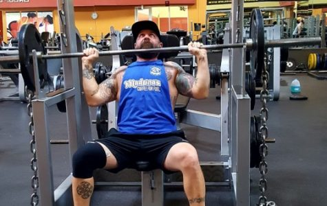 Patrick Longo shoulder presses 135 pounds at Gold's Gym St. Peters. <br> Photo by Lauren Grayek