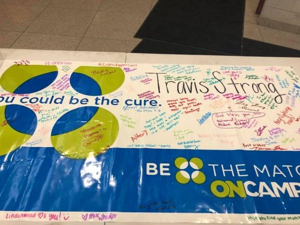 The+banner+at+the+bone+marrow+event+that+students+signed+in+honor+of+Travis+Russo.+Student+Involvement+and+the+Swimming+and+Diving+team+put+together+a+bone+marrow+drive+after+they+learned+that+Russo%27s+leukemia+returned.+%3Cbr%3E+Photo+from+Lindenwood+University%27s+Student+Involvement+Facebook+page+