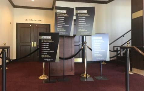 Warning signs stand outside the J.Schidegger Center's main theater. <br> File photo by Megan Courtney