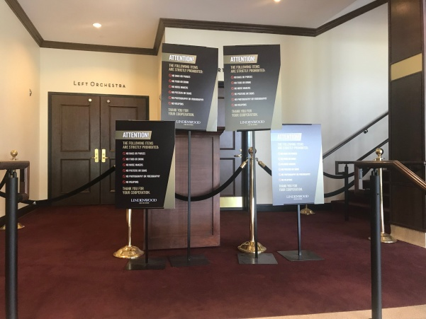 Warning signs stand outside the J.Schidegger Center's main theater.  File photo by Megan Courtney