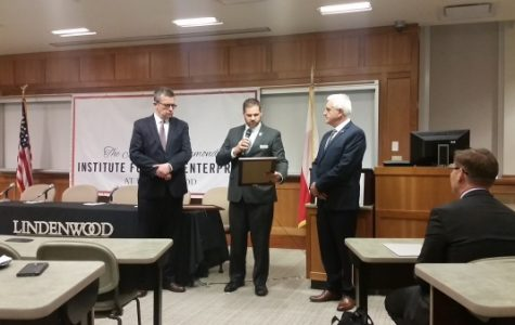 Ambassador Piotr Wilczek (left) and Dr. Wojciech Golik (right) accept their certificates of recognition from State Rep. Kurt Bahr. <br> Photo by Lindsey Fiala