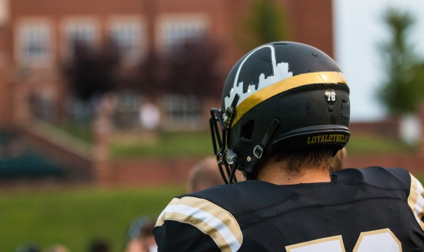 Lindenwood football player on the sideline in a game on Aug. 31, 2018