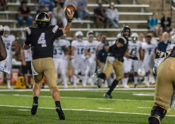 File photo: Freshman quarterback Cade Brister, one of this season's team captains, passes the ball during the game against Washburn in August.  Photo by Tyler Keohane.