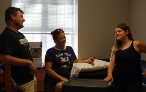Emily Manzer with her parents, Michele and Andy, in her dorm in Reynolds Hall. Michele got emotional when talking about Emily being 17 hours away from home for the first time. <br> Photo by Kat Owens