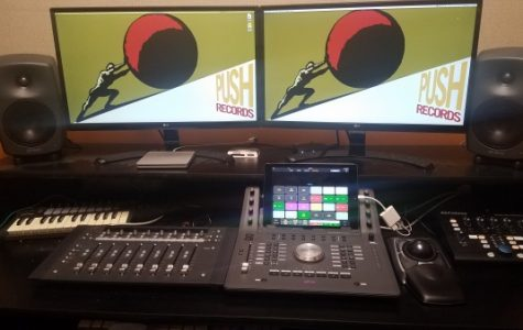 The current workspace in the control room, complete with a mixing board and speakers.  <br> Photo by Kayla Drake