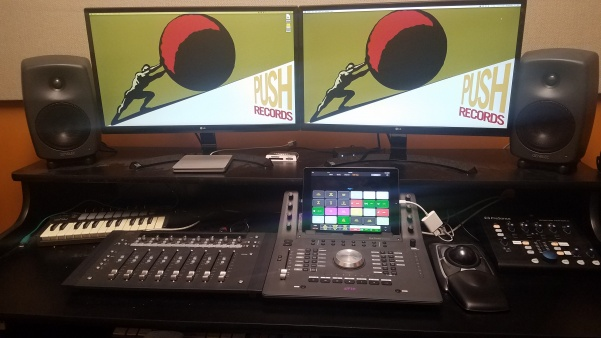 The current workspace in the control room, complete with a mixing board and speakers.   Photo by Kayla Drake