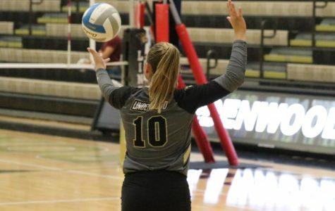 No. 10 Jenna Garrett serves in the third set against Washburn University on Friday night.  <br>Photo by Mina San Nicolás