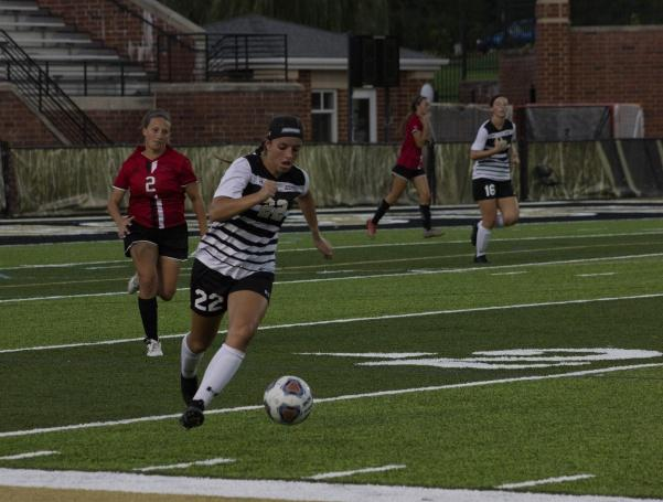 Midfielder+Olivia+Callipari+dribbles+the+ball+down+the+field+during+the+Sept.+3+game+against+Maryville+University.++Photo+by+Lindsey+Fiala