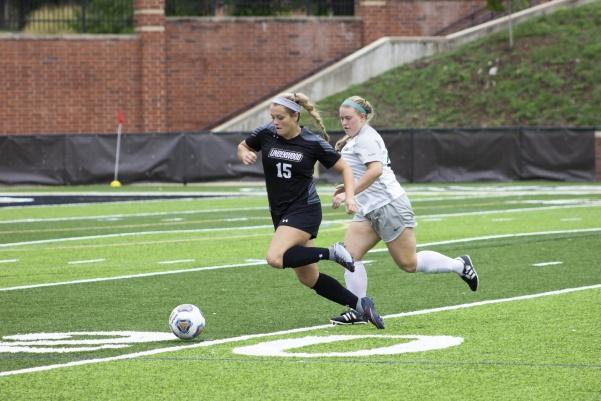 Forward Morgan Weller chases the ball down the field during a game against Missouri S&T.  Photo by Lindsey Fiala