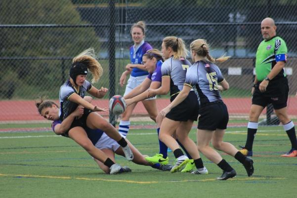 Lindenwood+freshman+Bella+DeVore+passes+ball+off+Saturday+before+being+tackled+by+Kansas+City+Jazz+senior+Alicia+Barry.+The+Lions+defeated+the+Jazz+82-14.%0A%3Cbr%3E+Photo+by+Lindsey+Fiala
