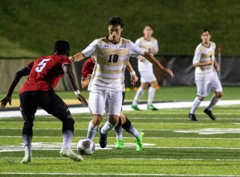 Lindenwood's midfielder Fernando Cordero attempts to dribble the ball past Maryville defender Muhammed Sanyang in the first half of the Lions' 3-0 loss to the Saints. <br> Photo by Tyler Keohane.
