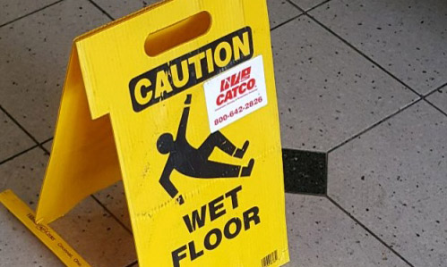 A wet floor sign in the lobby of Guffey Hall the day after the water damage.   Photo by Matt Hampton.
