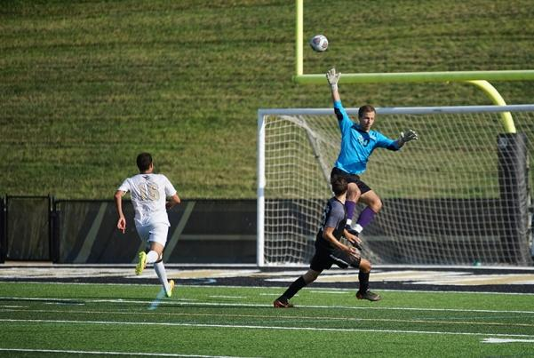 Lions goalkeeper Aleksa Nenadic attempts to stop a shot by Harding University forward Braeden Grundy near the end of the first half.  Photo by Mitchell Kraus