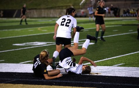 Lions midfielder Bailey Bologna falls over Missouri Southern State's Alex McCord during the second half.  Photo by Mitchell Kraus