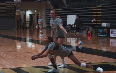 Freshman Mackenzi Sifuentes bumps the ball up in a drill while Sophomore Sadie Kosciuk waits for her turn during practice. <br> Photo by Lindsey Fiala