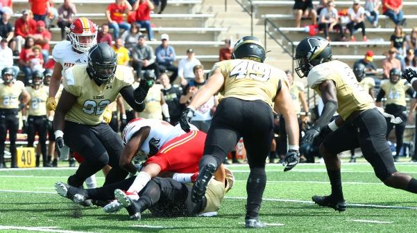 Linebacker Nate Blanchard (#49), defensive end Arsante Conners (#92), and defensive back Darrius Williams (#2) all swarm in on a Gorilla playmaker. Lions lost to Pittsburg State 27-24.  Photo by Kayla Drake
