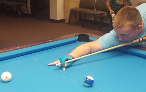 Justin Martin, a 19-year-old Team USA billiards player from North Carolina, prepares for a shot in the Lindenwood Billiards Arena.  <br /> Photo by Matt Hampton.