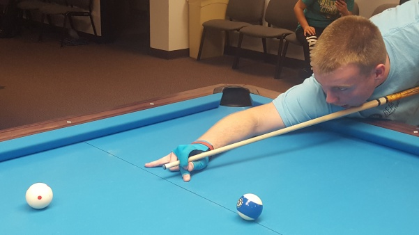 Justin Martin, a 19-year-old Team USA billiards player from North Carolina, prepares for a shot in the Lindenwood Billiards Arena.   Photo by Matt Hampton.