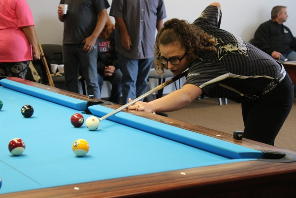 April+Larson%2C+a+freshman+majoring+in+finance%2C+prepares+to+execute+a+shot++in+the+Lindenwood+Billiards+Arena.+Larson+is+a+professional+player+and+billiards+national+champion.+%3Cbr+%2F%3E+Photo+by+Merlina+San+Nicol%C3%A1s