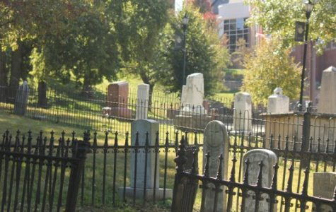 The cemetery on campus contains two fenced burial plots, some other scattered gravestones, and several unmarked graves.  <br /> Photo by Matt Hampton