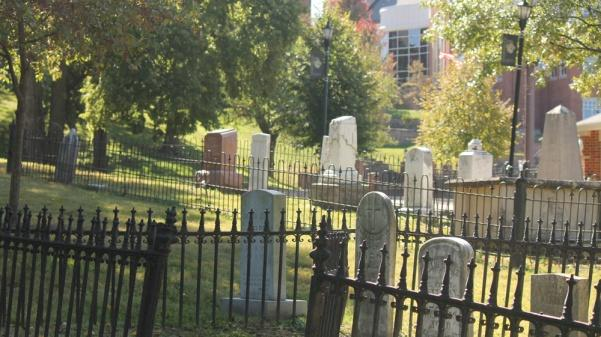 The cemetery on campus contains two fenced burial plots, some other scattered gravestones, and several unmarked graves.   Photo by Matt Hampton