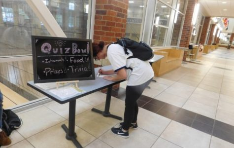 A student signs up for the Lindenwood Quiz Bowl, a new club coming to campus. Photo by Marquita Young.