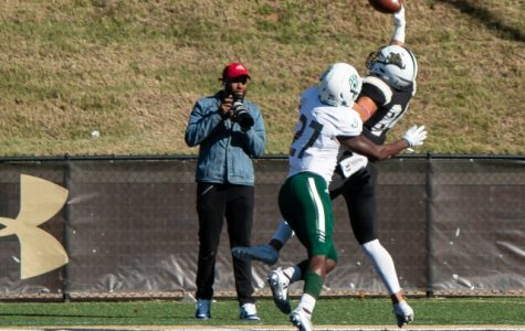 Lindenwood's Paul Silvio pulls in touchdown pass over cornerback J'Ravien Anderson in the third quarter of the Lions' 38-17 loss against Northwest Missouri State. <br> Photo by Tyler Keohane