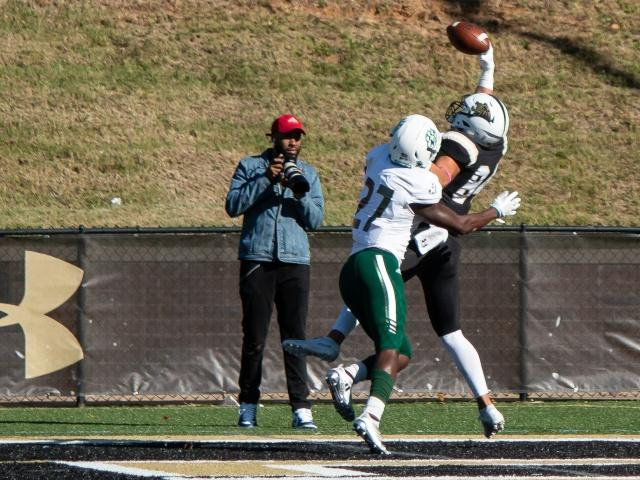 Lindenwood's Paul Silvio pulls in touchdown pass over cornerback J'Ravien Anderson in the third quarter of the Lions' 38-17 loss against Northwest Missouri State.  Photo by Tyler Keohane