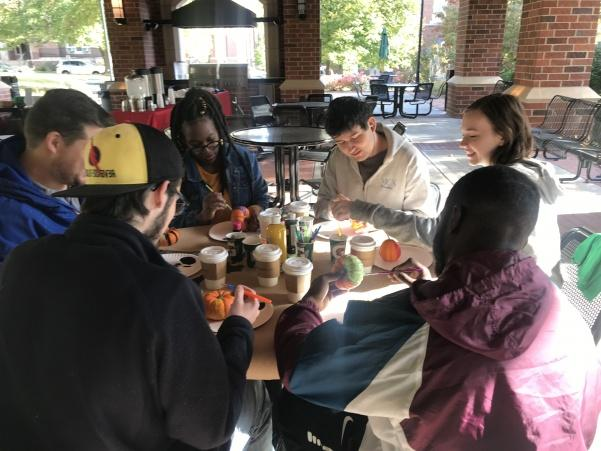 Commuter+students+of+Lindenwood+gather+under+the+pavilion%2C+located+on+heritage+side%2C+to+mingle+and+join+in+on+some+pumpkin+decorating.++Photo+by+Lauren+Pennock.
