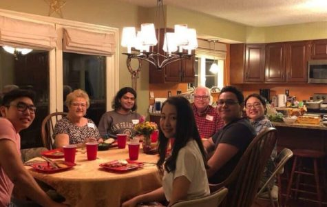 Maryann Vest and Steve Vest having dinner with international students at their house on Sept. 29. <br> Photo by Sandy Leegumjorn