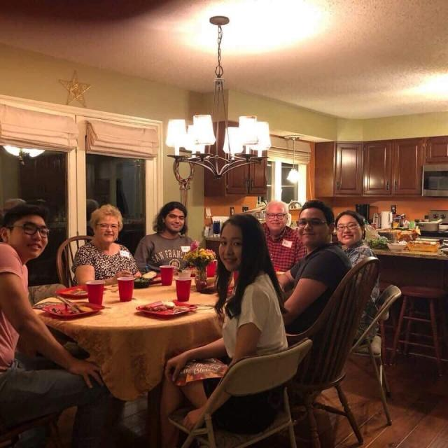 Maryann Vest and Steve Vest having dinner with international students at their house on Sept. 29.  Photo by Sandy Leegumjorn