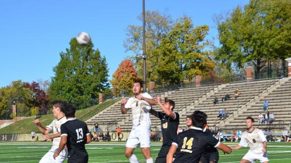 Sophomore Joshua Scholl (6) heads a corner kick in the second half.   Photo by Maria Escalona.