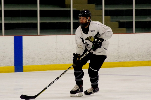 File photo: Defender Jake Townsend (#21) keeps an eye on the puck during practice in the Wentzville Ice Arena.