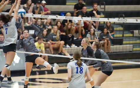 Lindenwood freshman Hannah Borchelt, #9, attacks the ball past defending Nebraska-Kearney Lopers. The Lions put up a good fight but lost the match 3-0.  Photo by Mitch Kraus.